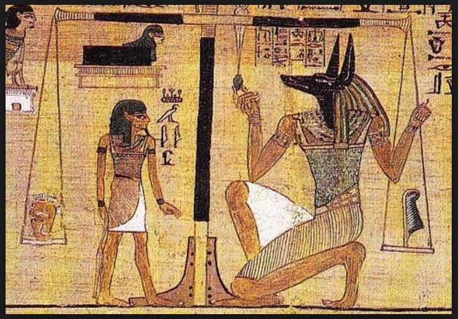 Anubis, weighing the heart of the recently dead