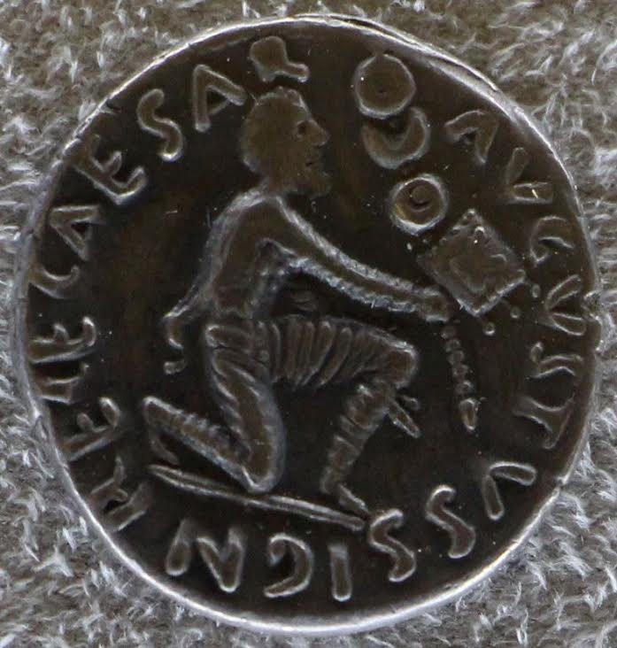 Roman coin showing Parthian return of Roman Standards