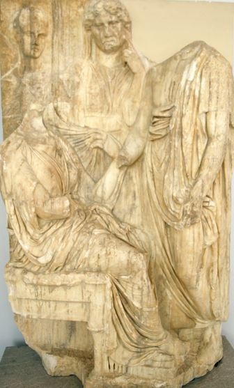 Funerary monument of a woman who died in childbirth showing her bidding farewell to her husband, mother and nurse who will care for her child