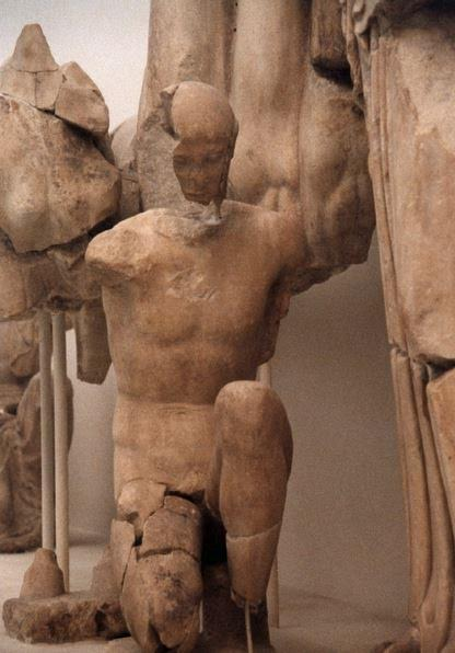 Figure of Mytilus on East Pediment of Temple of Zeus - See him kneeling to switch the pins of Oinomaus' chariot wheel?