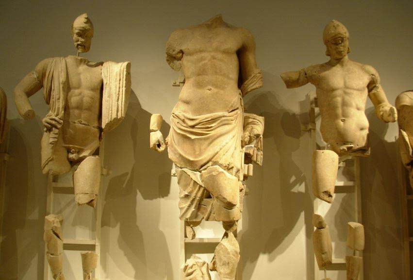 Pelops on East Pediment of Temple of Zeus - Pelops is to Zeus' right, and Oinomaus to the left.
