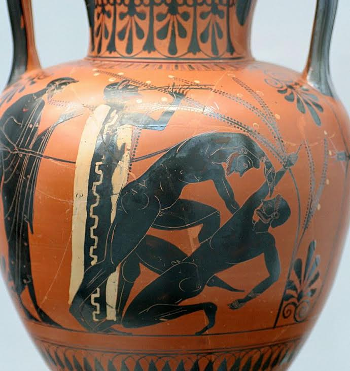 vase showing boxing match with musical accompaniment and judge